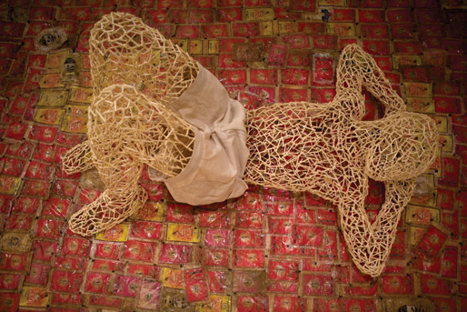 """Aimé Mpane, """"A Bomb with a Time-Delay"""", 2007, broken glass, figure made of stems of matches on plastic carpet, variable dimension"""
