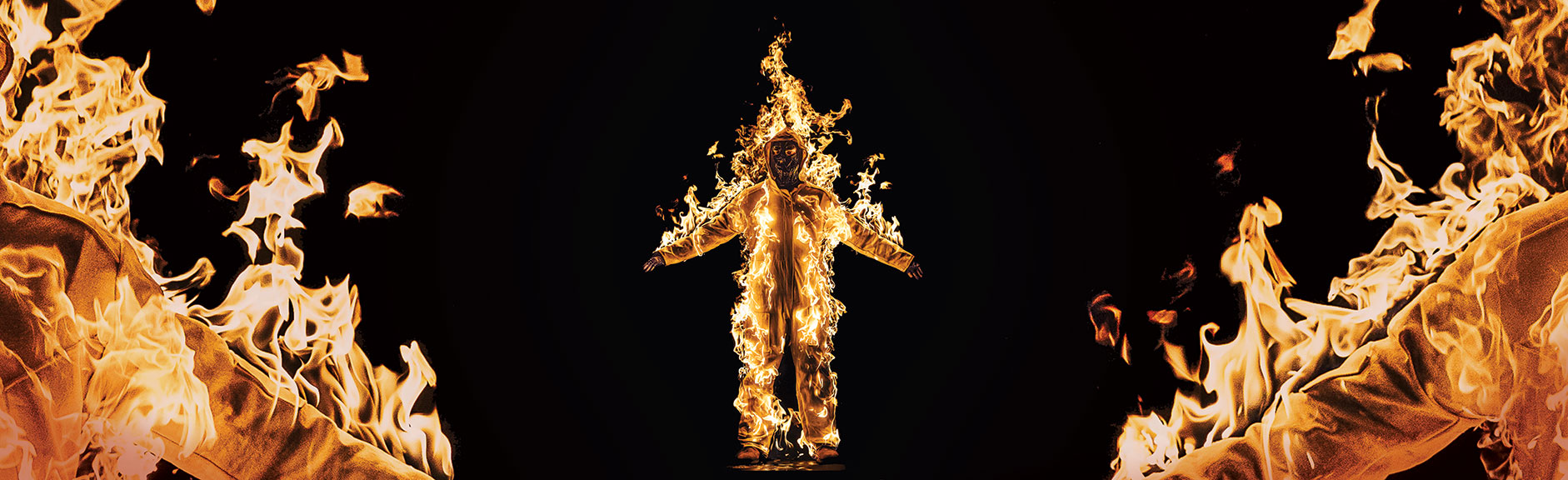 Cassils is lit on fire during their performance Inextinguishable Fire, performed on Nov 8, 2015 at the National Theatre, London, UK, as part of SPILL Festival of Performance. Photo credit: Cassils with Guido Mencari © Cassils 2015 Image courtesy of the artist and Ronald Feldman Fine Arts